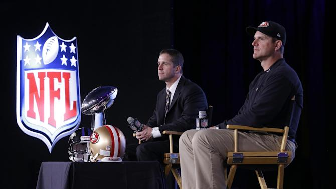 San Francisco 49ers head coach Jim Harbaugh and Baltimore Ravens head coach John Harbaugh participate in a news conference for the NFL Super Bowl XLVII football game Friday, Feb. 1, 2013, in New Orleans. (AP Photo/Patrick Semansky)