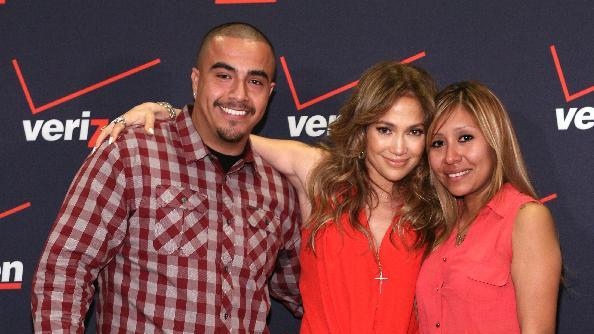 IMAGE DISTRIBUTED FOR VERIZON WIRELESS - From left, Carlos Espinoza of Los Angeles, Jennifer Lopez and Carlos's girlfriend are seen at the Verizon Wireless meet Jennifer Lopez Flyaway Contest, on Saturday, Jan. 26, 2013 in Santa Monica, Calif. (Photo by Casey Rodgers/Invision for Verizon Wireless/AP Images)