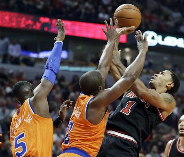 Chicago Bulls guard Derrick Rose (1) shoots over New York Knicks guard Raymond Felton (2) and guard Tim Hardaway Jr during the second half of an NBA basketball game in Chicago, Thursday, Oct. 31, 2013