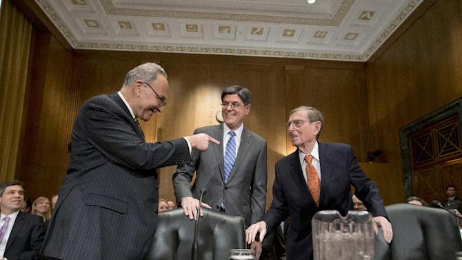 FILE - In this Wednesday, Feb. 13, 2013, file photo, Jack Lew President Barack Obama's choice to be treasury secretary, center, talks with Sen. Charles Schumer, D-N.Y., left, and former New Mexico Sen. Pete Domenici. The Senate Finance Committee on Tuesday, Feb. 26, 2013, approved President Barack Obama's choice of Jacob Lew to be Treasury secretary and sent the nomination to the full Senate.  (AP Photo/J. Scott Applewhite, File)
