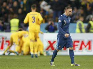 France's Franck Ribery walks after Ukraine's Andriy Yarmolenko celebrates his goal with team mates during the 2014 World Cup qualifying first leg playoff soccer match at the Olympic stadium in Kiev