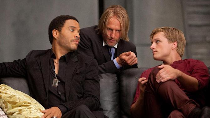 "In this image released by Lionsgate, from left, Lenny Kravitz portrays Cinna, Woody Harrelson portrays Haymitch Abernathy and Josh Hutcherson portrays Peeta Mellark in a scene from ""The Hunger Games."" (AP Photo/Lionsgate, Murray Close)"