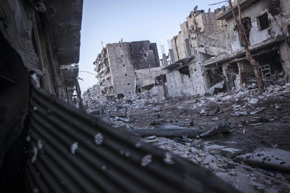 In this Thursday, Nov. 1, 2012 photo, a general view of a front line street destroyed by heavy shelling and fighting is seen in the Karmal Jabl battlefield in Aleppo, Syria. (AP Photo/Narciso Contreras)