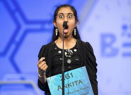 """Ankita Vadiala of Manassas, Virginia, reacts to the word """"ballabile"""", which she spelled correctly, during the semi-final round of the 88th annual Scripps National Spelling Bee"""
