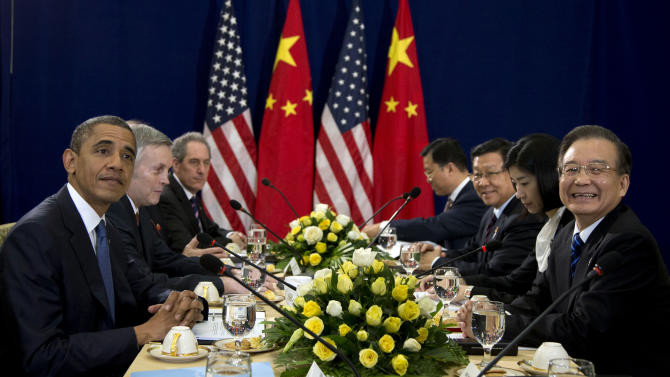 U.S. President Barack Obama, left, meets with Chinese Premier Wen Jiabao , right, during the East Asia Summit at the Peace Palace in Phnom Penh, Cambodia, Tuesday, Nov. 20,  2012. (AP Photo/Carolyn Kaster)