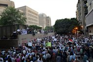 <p>Thousands protest outside the US embassy in Cairo, on September 11, against a film deemed offensive to Islam. The protesters, angered by the film produced by expatriate members of Egypt's Christian minority residing in the United States, tore down the US flag during the protest at the embassy.</p>