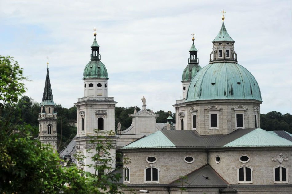The steeples of Salzburg cathedral and the Franciscan church (L) in Salzburg, Austria. The Salzburg Festival is a prominent festival of music and drama established in 1920 and is held each summer with