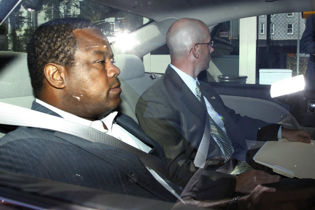 Trenton Mayor Tony Mack, left, is driven in custody into the federal courthouse in Trenton, N.J., Monday, Sept. 10, 2012, after agents arrested him earlier Monday as part of an ongoing corruption inve