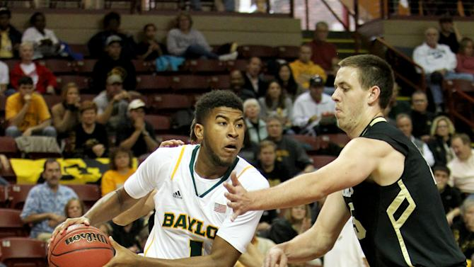 Baylor's L.J. Rose, left, drives to the basket past Colorado's Shane Hariis-Tunks, during the first half of an NCAA college basketball game at the Charleston Classic at TD Arena, Friday Nov. 16, 2012, in Charleston, S.C. (AP Photo/Alice Keeney)