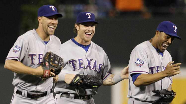 Texas Rangers center fielder Josh Hamilton, center, walks off the field with left fielder David Murphy, left, and right fielder Nelson Cruz after a baseball game against the Baltimore Orioles in Baltimore, Tuesday, May 8, 2012. Texas won 10-3. Hamilton had four home runs (AP Photo/Patrick Semansky)
