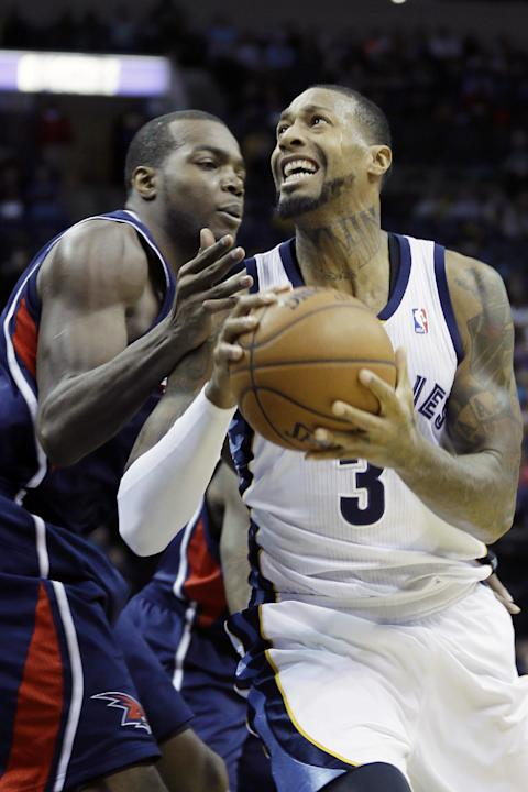 Memphis Grizzlies' James Johnson (3) looks toward the basket in front of Atlanta Hawks' Paul Millsap, left, in the second half of an NBA basketball game in Memphis, Tenn., Sunday, Jan. 12, 201
