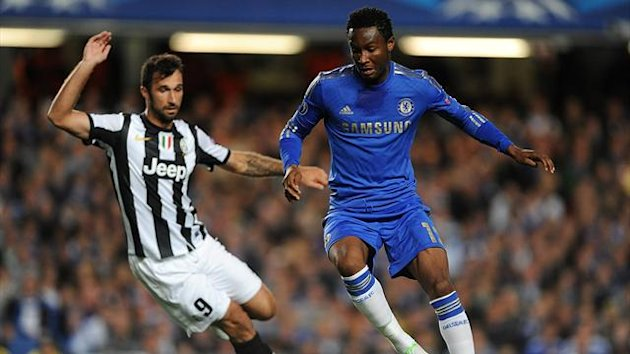 Juventus' Mirko Vucinic (left) and Chelsea's Mikel battle for the ball