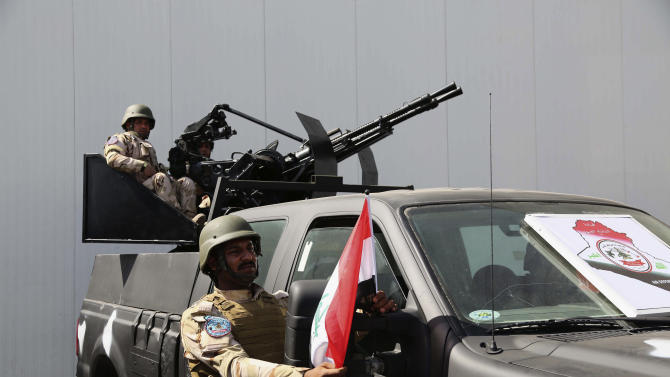 Weaponry is on display at a weapons exhibition organized by the Iraqi defense ministry at the Baghdad International Fairgrounds in Baghdad, Iraq, Saturday, March 1, 2014. Companies from Japan, U.S., Germany, Egypt, China and others displayed armored vehicles, sample models of aircraft and light and medium weaponry. (Karim Kadim)