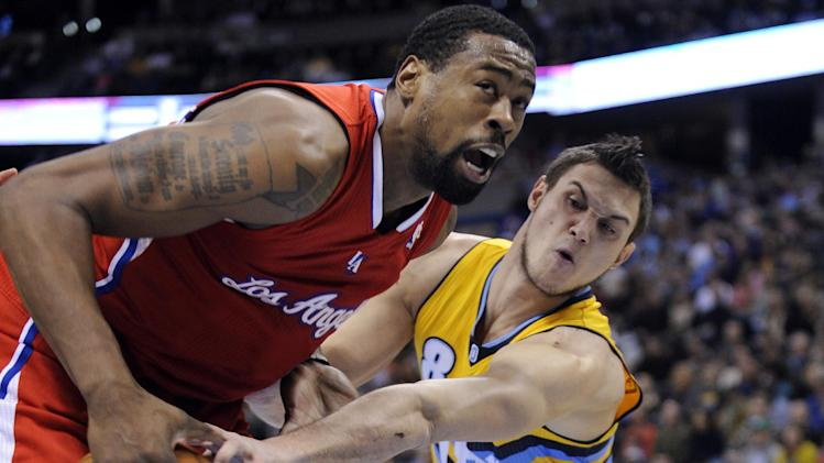 Denver Nuggets forward Danilo Gallinari (8), from Italy, knocks the ball loose from Los Angeles Clippers center DeAndre Jordan (6) during the first quarter of an NBA basketball game, Tuesday, Jan. 1, 2013, in Denver. (AP Photo/Jack Dempsey)