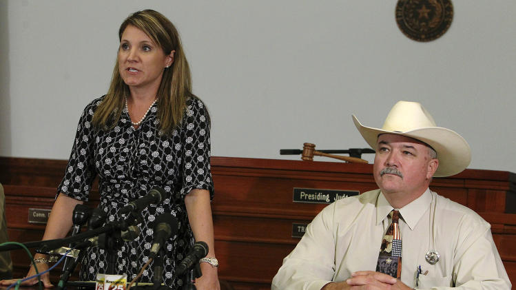 25th Judicial District Attorney Heather McMinn, left, and Lavaca County Sheriff Mica Harmon appear at a news conference in Halletsville, Texas on Tuesday, June 19, 2012 to announce that a grand jury declined to return an indictment against a young father who beat to death Jesus Mora Flores for molesting the man's five-year-old daughter. (AP Photo/San Antonio Express-News, Kin Man Hui) RUMBO DE SAN ANTONIO OUT; NO SALES, MAGS OUT