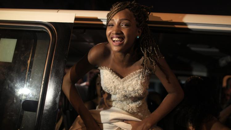 Mariana Reies enters a vehicle waiting to take her to the debutante ball in Rio de Janeiro