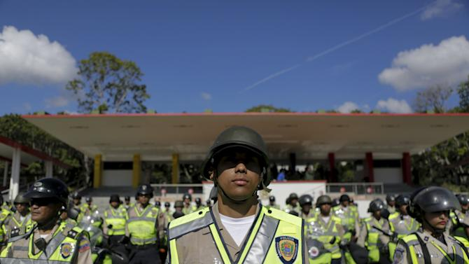 Venezuela's police officers attend a ceremony to kick off the distribution of voting materials at Fort Tiuna military base in Caracas