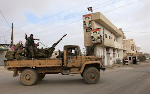 Syrian government forces patrol in Sadad, a majority…