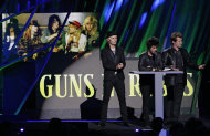 Green Day's Tre Cool, right, Billy Joe Armstrong, second from right, and Mike Dirnt introduce Guns N' Roses for induction into the Rock and Roll Hall of Fame Saturday, April 14, 2012, in Cleveland. (AP Photo/Tony Dejak)
