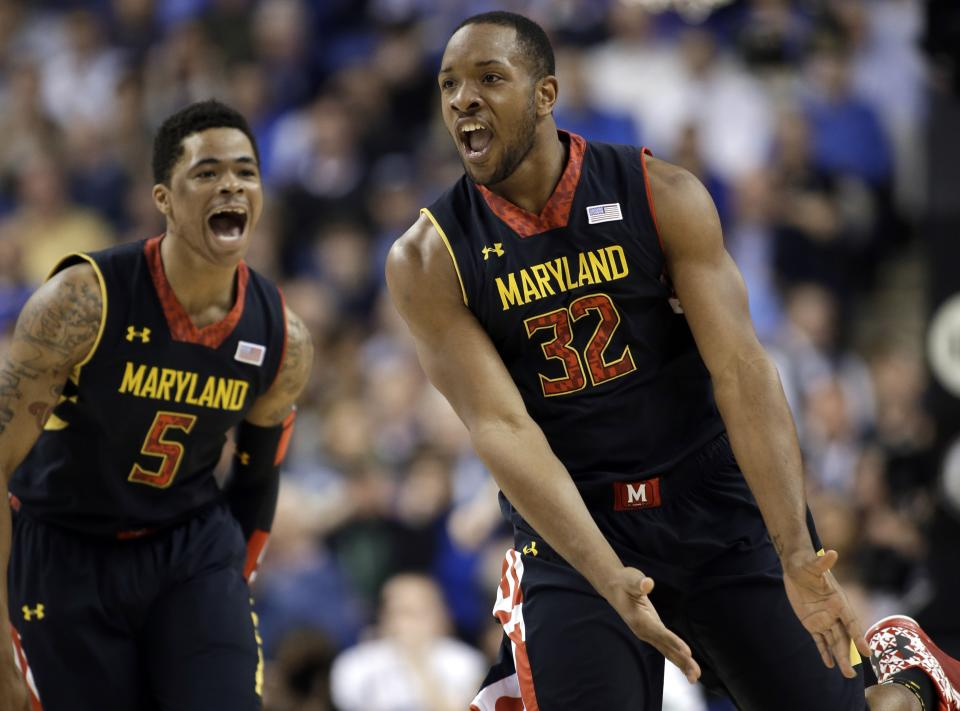 Maryland's Dez Wells (32) and Nick Faust (5) react after a basket against Duke during the first half of an NCAA college basketball game at the Atlantic Coast Conference men's tournament in Greensboro, N.C., Friday, March 15, 2013. (AP Photo/Bob Leverone)
