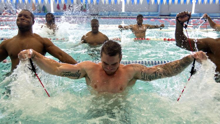 Oakland Raiders wide receiver Nick Miller, center, works out with teammates at an indoor pool Thursday, May 26, 2011 in Lawrenceville, Ga. (AP Photo/David Goldman)