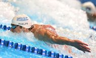 Michael Phelps swims to a first place finish in the men's 100m butterfly final on day seven of the 2012 US Olympic Team Trials in Omaha, Nebraska. Phelps won't try to replicate his glittering eight-gold haul of 2008 at the London Olympics, coach Bob Bowman said Monday