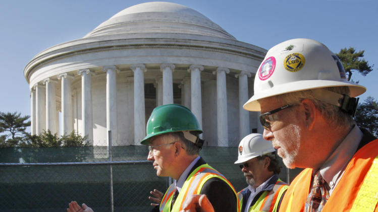 Interior Secretary Ken Salazar, left, tours restoration work at the Thomas Jefferson Memorial with Kevin Waldron, and Phil Sheridan, in Washington, Tuesday, Nov. 9, 2010.  (AP Photo/Jacquelyn Martin)
