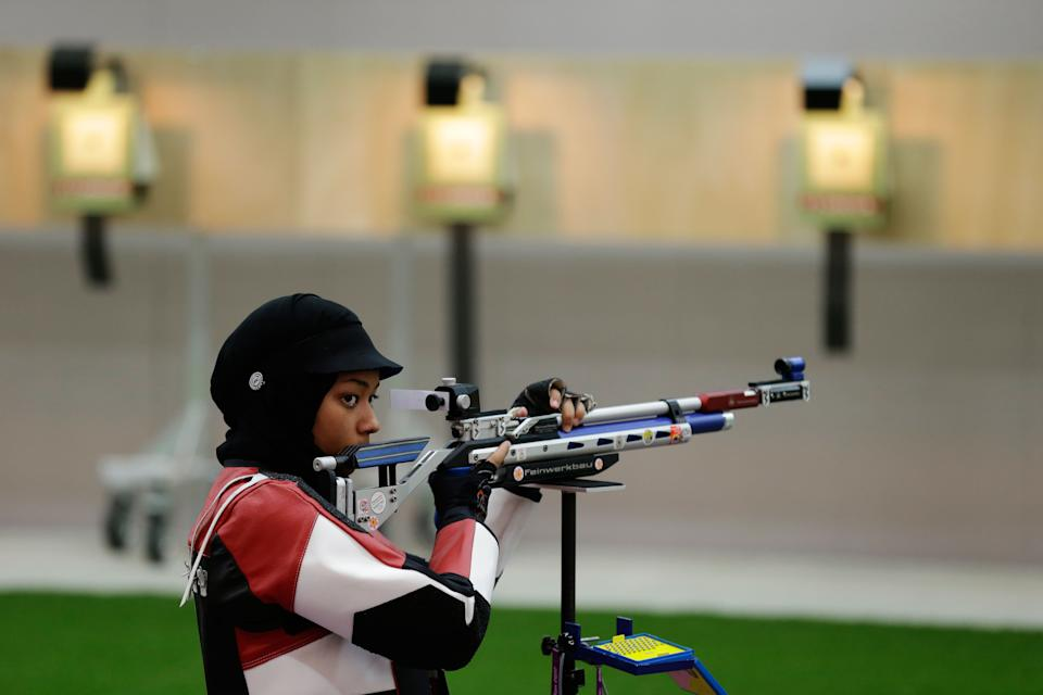 Qatar's Bahya Al Hamad trains for the 10-meter air rifle, at the Royal Artillery Barracks, ahead of the opening of the 2012 Summer Olympics, Wednesday, July 25, 2012, in London. (AP Photo/Rebecca Blackwell)