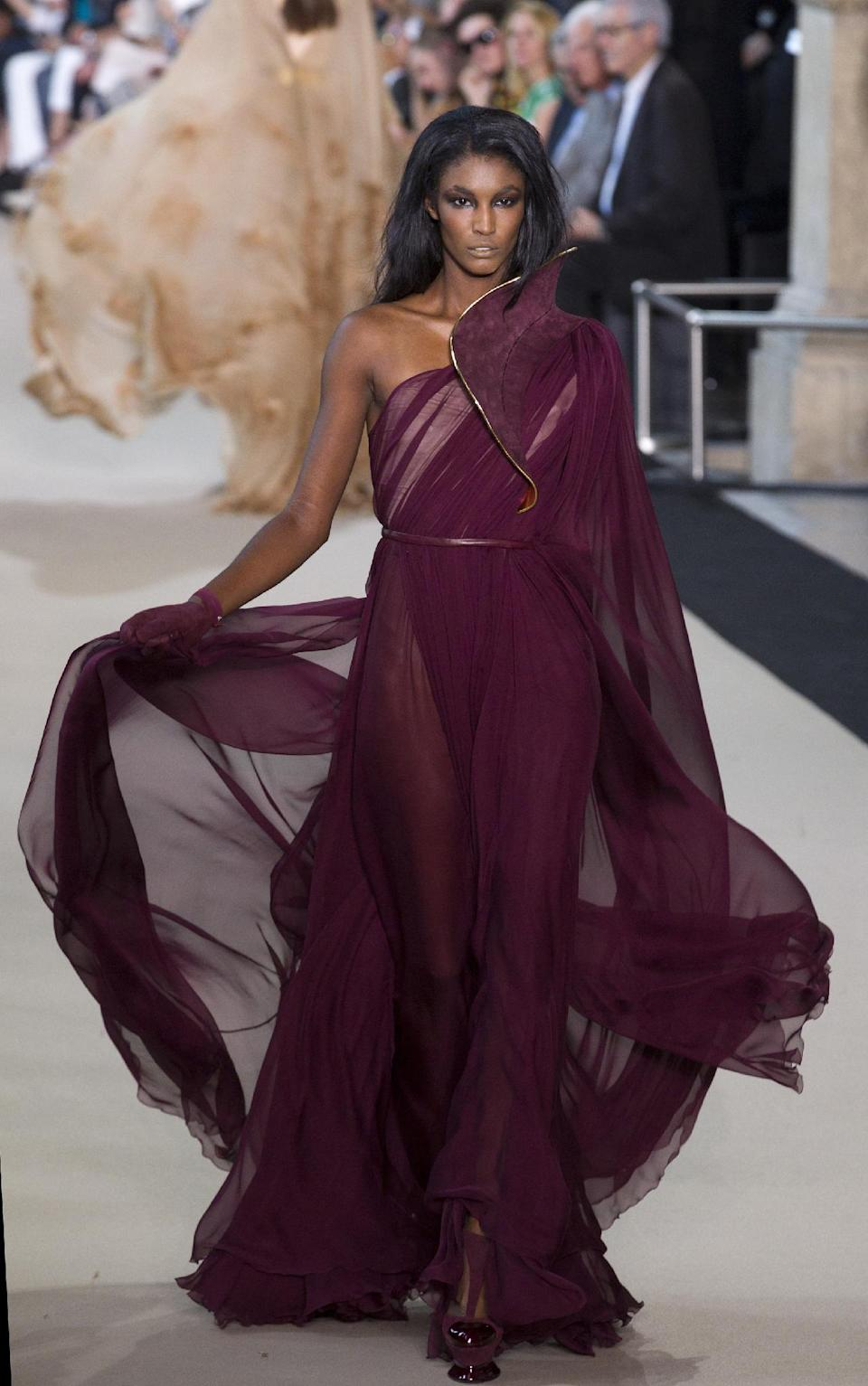 A model wears a creation by French designer Stephane Rolland as part of his presentation for Women's Fall Winter 2013 haute couture fashion collection, in Paris, France, Tuesday, July 3, 2012. (AP Photo/Jacques Brinon)