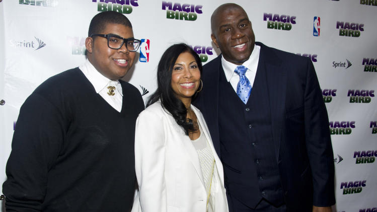 """FILE - This April 11, 2012 file photo shows Magic Johnson, right, his wife Cookie and son E.J. arriving for the opening night performance of the Broadway play """"Magic/Bird"""" in New York. The 20-year-old son of basketball great Magic Johnson is surprised by the public interest in his being gay, something that he revealed to his supportive family several years ago. Earvin Johnson III, known as E.J., says he feels like he's coming out of the closet a second time and that he's """"reveling"""" in the experience _ even though news of his sexual orientation broke publicly sooner than he had planned. (AP Photo/Charles Sykes, File)"""