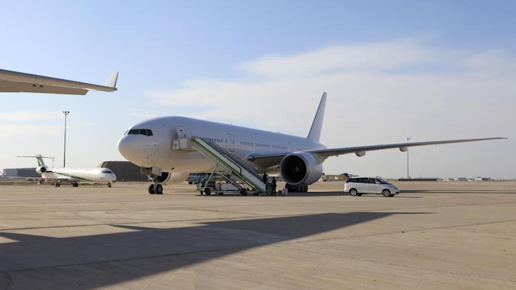 A Boeing 777 plane is seen after landing in Baghdad, Iraq, Saturday, Dec. 15, 2012. The first new Boeing jetliner sold to Iraq in years touched down in Baghdad on Saturday, signaling the country's determination to rebuild its economy after decades of war and sanctions. (AP Photo/Karim Kadim)