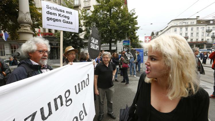 A woman shouts against protestors demanding peace for Palestine during a demonstration in Zurich