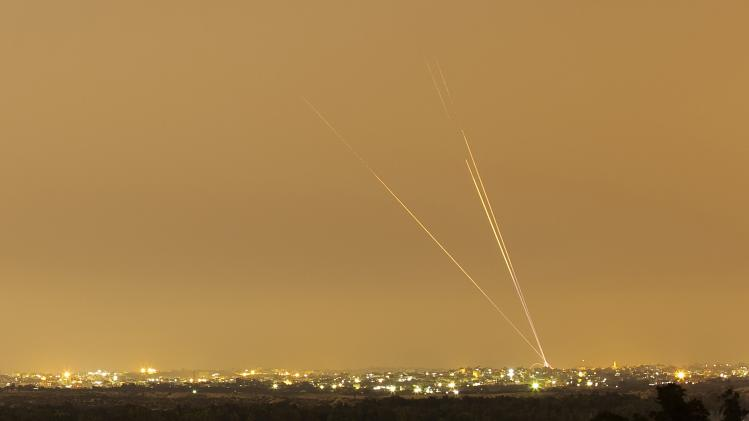 Smoke trails are seen as rockets are launched towards Israel from the northern Gaza Strip