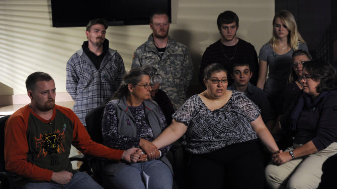 The family of Jessica Ridgeway gathers at the Westminster Police Department in Westminster, Colo., on Tuesday, Oct. 9, 2012, to talk about Jessica and ask for her safe return. In the front row from left are, Jessica's dad, Jeremiah Bryant, Jessica's great aunt, Gay Moore, Jessica's mother, Sarah Ridgeway, and Jessica's grandmother Christine Ridgeway. Jessica went missing Friday while on her way to school. (AP Photo/The Denver Post, Kathryn Scott Osler, Pool)