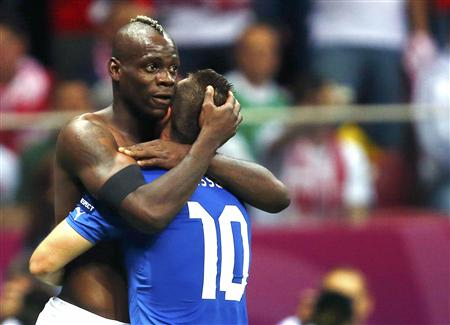 Italy's Balotelli celebrates with Cassano his second goal against Germany during their Euro 2012 semi-final soccer match at National Stadium in Warsaw