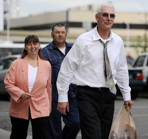 David Stone, right, and wife Tina Stone, left, arrive at the Federal courthouse in Detroit on Wednesday, Aug. 8, 2012. A federal judge must decide whether to send Stone, the leader of a Michigan militia, and his son to prison for possessing illegal weapons. David Stone and Joshua Stone pleaded guilty in March after a judge dismissed many more serious charges against them and members of the Hutaree. (AP Photo/The Detroit News, David Coates) DETROIT FREE PRESS OUT, NO MAGS, NO SALES