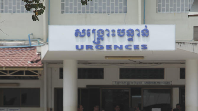Cambodian police officers stand guard in front of the emergency room at the hospital where former Khmer Rouge leader Ieng Sary died in Phnom Penh, Cambodia. Ieng Sary, who co-founded Cambodia's brutal Khmer Rouge movement in 1970s, was its public face abroad and decades later became one of its few leaders to be put on trial for the deaths of an estimated 1.7 million people, died Thursday morning. He was 87. (AP Photo/Heng Sinith)