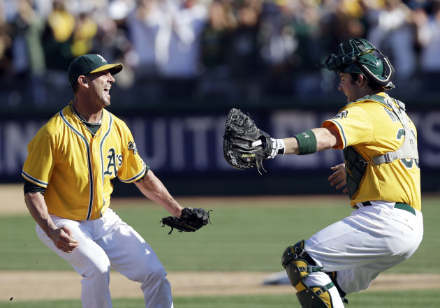 Oakland Athletics relief pitcher Grant Balfour, left, and catcher Derek Norris celebrate after their 12-5 win over the Texas Rangers in a baseball game, Wednesday, Oct. 3, 2012 in Oakland, Calif. The A&#39;s clinch the AL West title with the win. (AP Photo/Marcio Jose Sanchez)