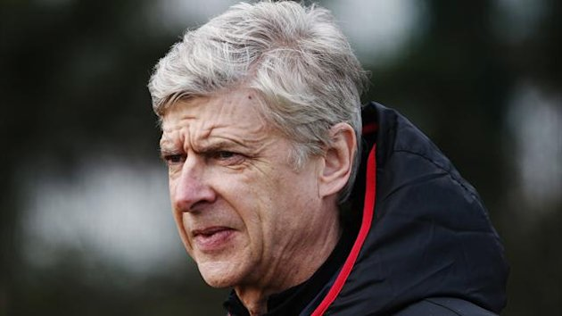 Arsenal manager Arsene Wenger attends a team training session at their training ground in London Colney February 18, 2013 (Reuters)