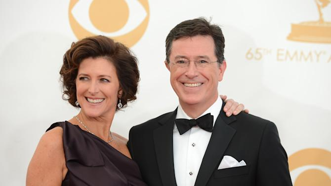 Stephen Colbert, right, and Evelyn McGee-Colbert arrive at the 65th Primetime Emmy Awards at Nokia Theatre on Sunday Sept. 22, 2013, in Los Angeles. (Photo by Jordan Strauss/Invision/AP)