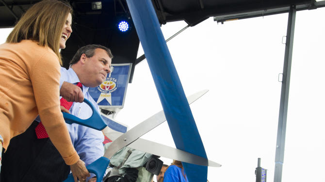 New Jersey Gov. Chris Christie and his wife Mary Pat cut a ribbon to symbolically reopen the state's shore for the summer season during NBC's Today Show on Friday, May  24, 2013 in Seaside Heights, N.J. (Photo by Charles Sykes/Invision/AP)