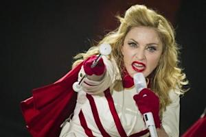 US pop singer Madonna performs during a concert of her MDNA world tour in Berlin