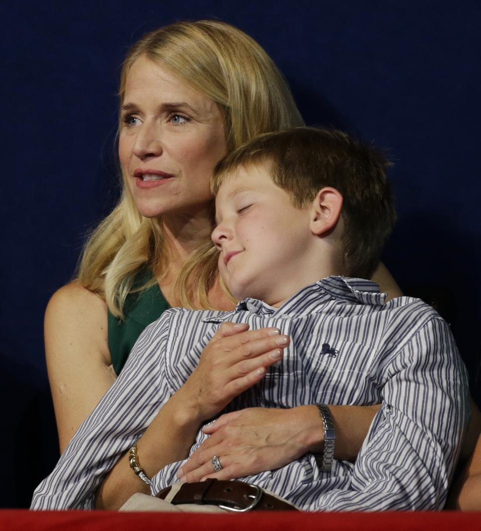 Sam Ryan sleeps in his mother's arms while Republican vice presidential nominee, Rep. Paul Ryan speaks during the Republican National Convention in Tampa, Fla., on Wednesday, Aug. 29, 2012. (AP Photo/Charlie Neibergall)