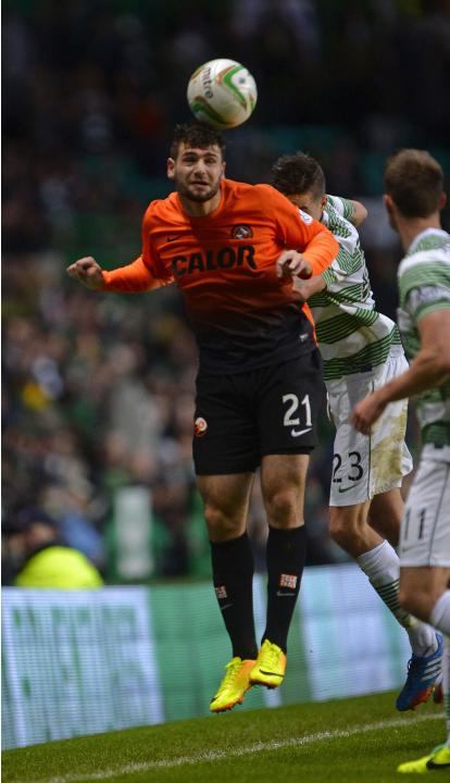 Dundee United's Ciftci is challenged Celtic's Lustig during Scottish Premier League in Glasgow, Scotland