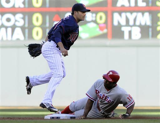 Twins pummel Phillies pitching in 11-7 win
