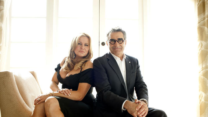 "In this March 18, 2012 photo, actors Jennifer Coolidge, left, and Eugene Levy pose for a portrait during a media day for the upcoming feature film ""American Reunion"" in Los Angeles. The film opens nationwide on Friday, April 6. (AP Photo/Dan Steinberg)"