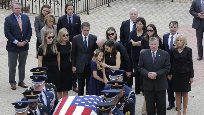 Natalie Biden, center, is comforted by her grandfather, Vice President Joe Biden, and her mother Hallie as they follow an honor guard carrying a casket containing the remains of her father, former Delaware Attorney General Beau Biden, Thursday, June 4, 2015, at Legislative Hall in Dover, Del. Beau Biden died of brain cancer Saturday at age 46. (AP Photo/Patrick Semansky, Pool)