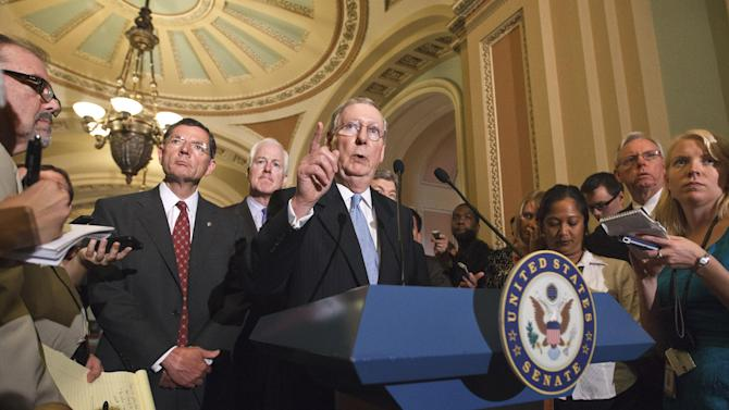 Senate Minority Leader Mitch McConnell of Ky., accompanied by fellow GOP leaders, talk to reporters on Capitol Hill in Washington, Tuesday, July 31, 2012, following a political strategy session. From left are, Sen. John Barrasso, R-Wyo.,  Sen. John Cornyn, R-Texas and McConnell.  (AP Photo/J. Scott Applewhite)