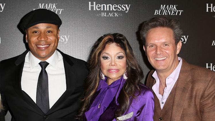Left to right, LL Cool J, La Toya Jackson and Mark Burnett attend Hennessy Black: A Dinner with LL Cool J and Mark Burnett Celebrating Music's Biggest Night Out, on Sat., Feb., 9, 2013 in Los Angeles. (Photo by Casey Rodgers/Invision for Hennessy/AP Images)