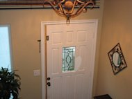 Insulate your front door with molding flanked with a vinyl seal. Once you paint the molding, the seal will disappear from sight.
